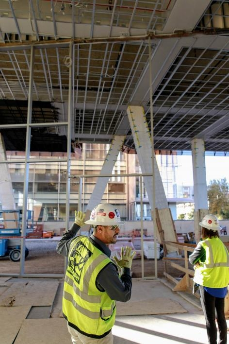 McCarthy Construction project manager Carlos Diaz leads a tour
