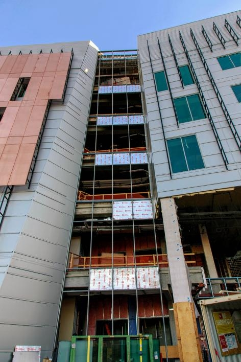 Above ground, floor-to-ceiling windows and copper paneling will soon fill in the building exterior