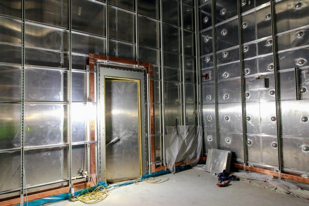 This vault's custom-welded paneling acts as a Faraday cage to shield the CXFEL.