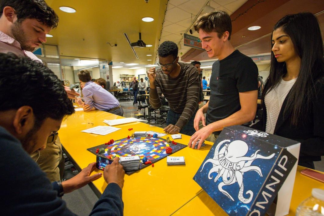 Students play a board game.
