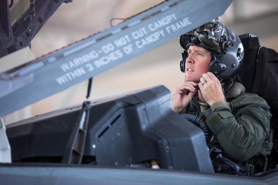 Pilot straps on his helmet