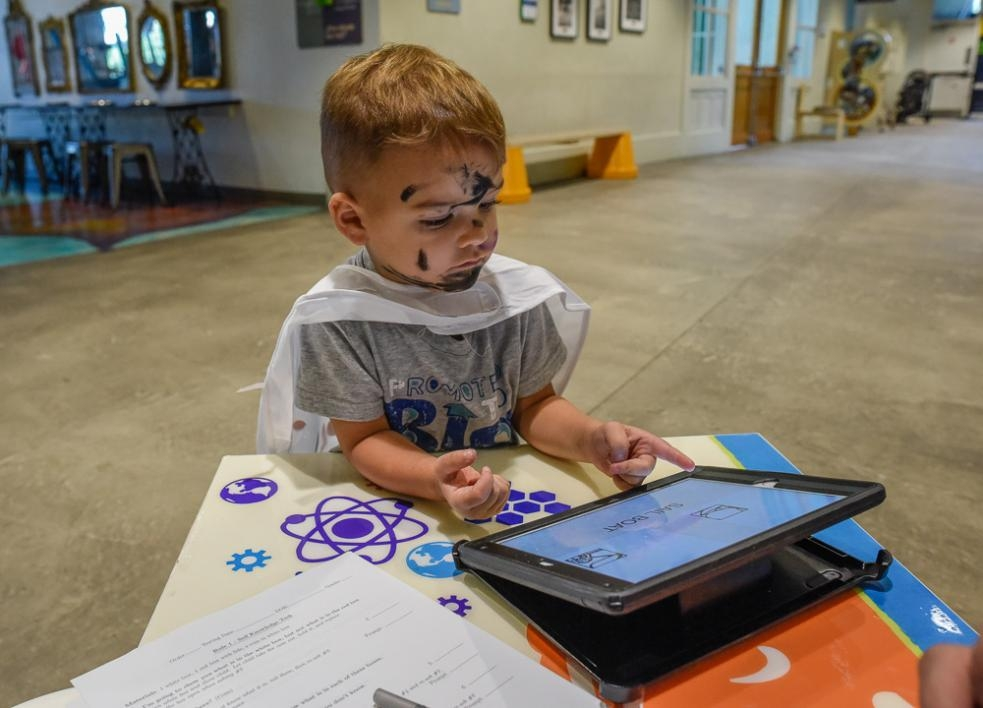 Child performing memory game at the Children's Museum