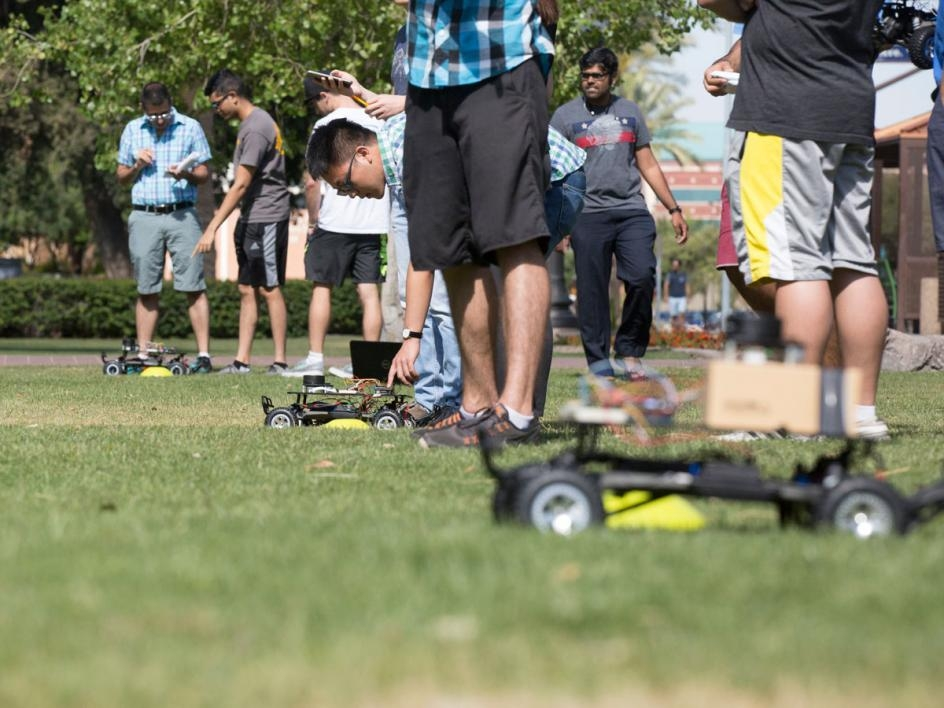 Teams line up for the final project of the semester — a race to earn some extra credit. Students competed at Old Main lawn in five heats of three teams, avoiding obstacles and navigating to a destination. Teams who reached the destination without hitting