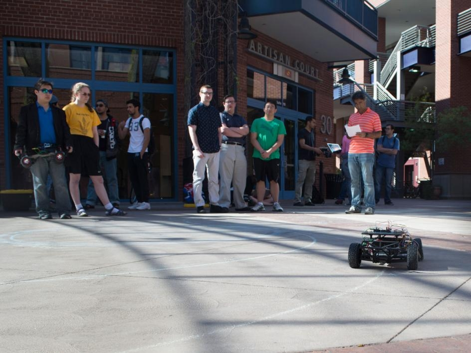In the first demonstration, each team of two had to program their car to use an inertial measurement unit (IMU) sensor to keep its steering on path to create a figure 8 of two circles with different diameters. Photographer: Mihir Bhatt/ASU