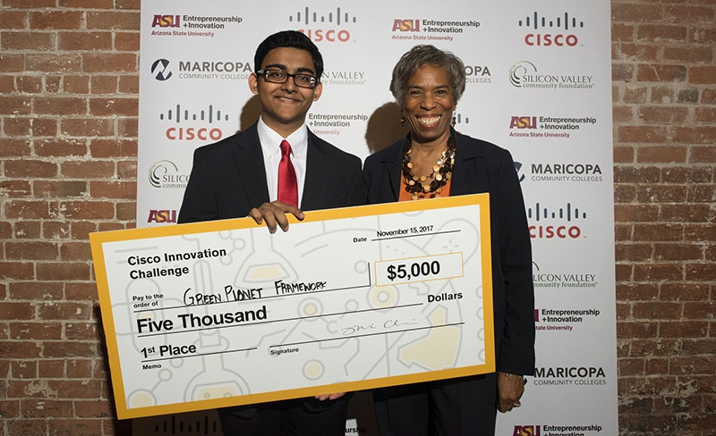 Cisco Innovation Challenge winner Joshua Pardhe (left) with fellow entrepreneur and Challenge judge, Loretta Love Huff. Photo by Laura Segall.