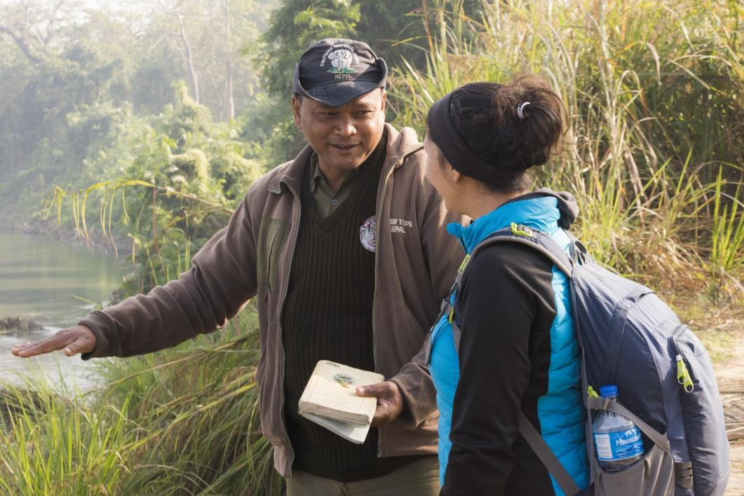 Michele Clark speaking with a guide at Chitwan National Park