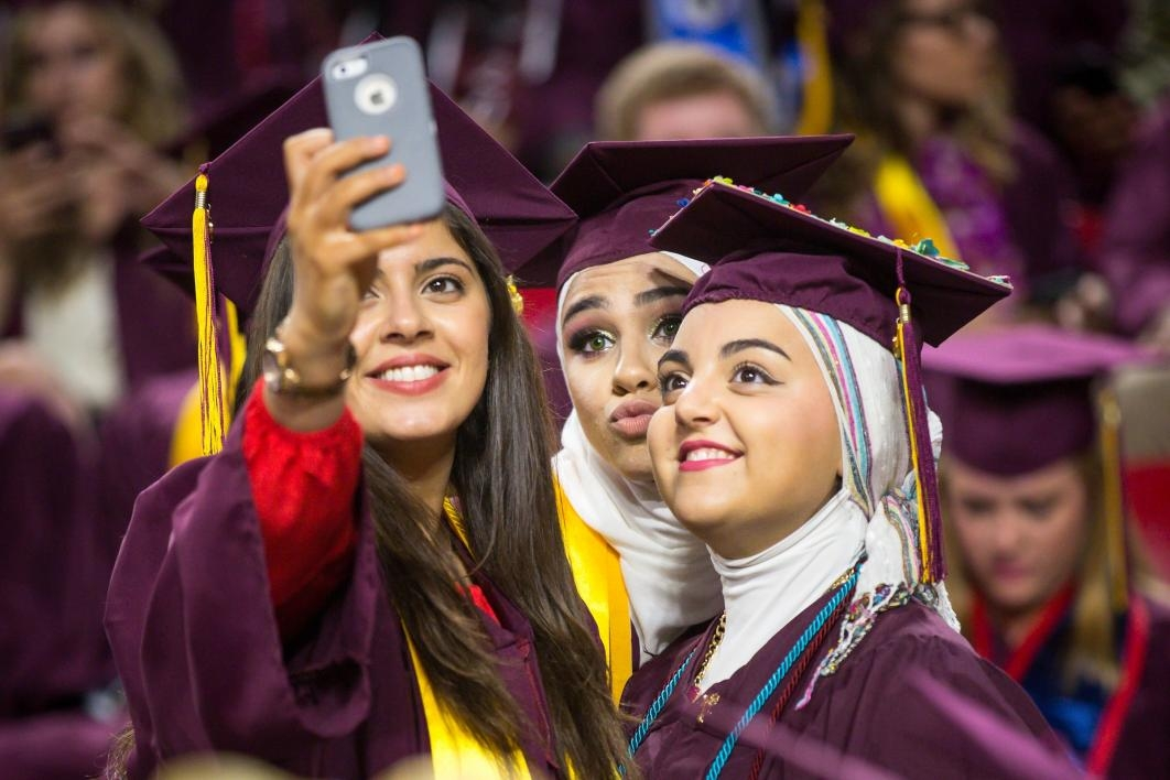 graduates posing for selfie
