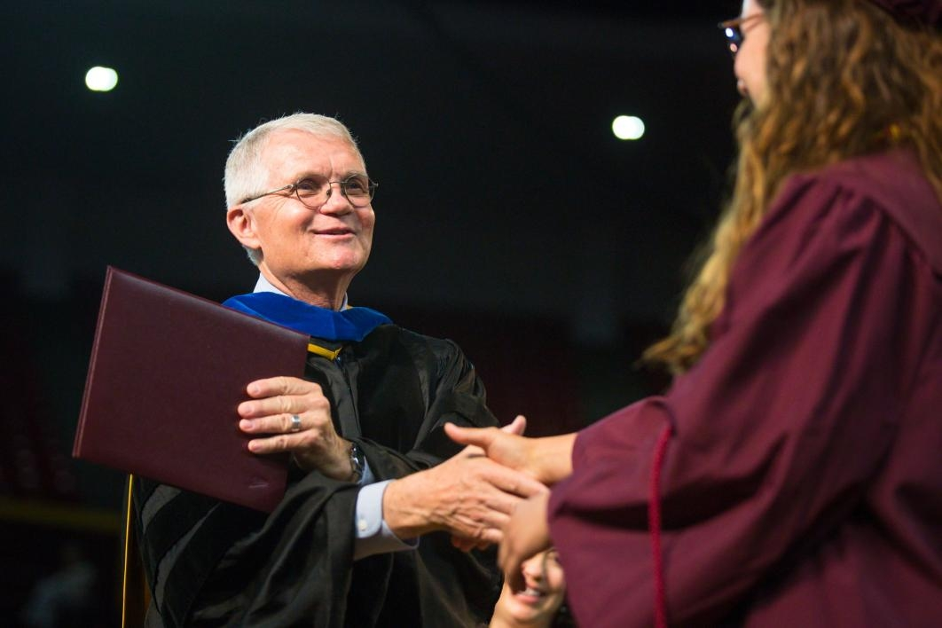 dean shaking graduate's hand