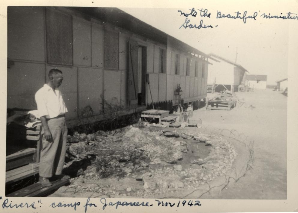 man standing outside his home next to a garden
