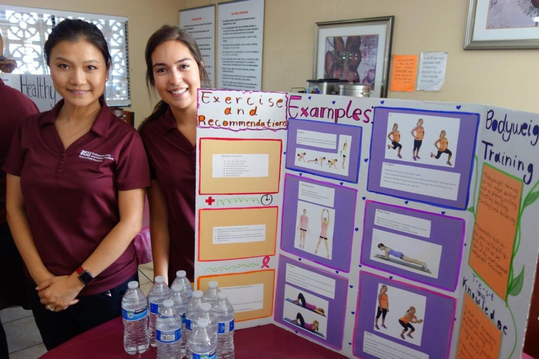 ASU nursing students pose with the poster they created for a health fair