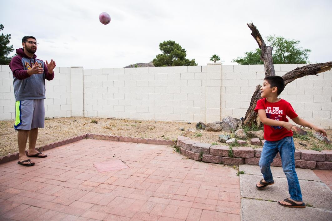 man throwing football with boy