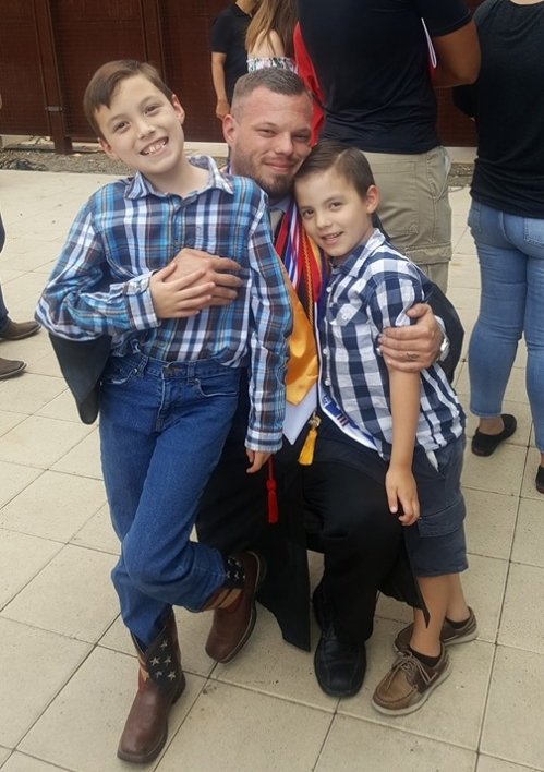 Bennett with his two sons