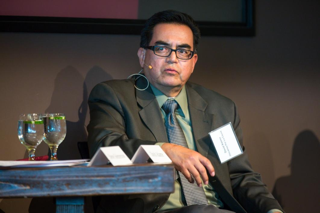 A man speaks during a discussion panel.