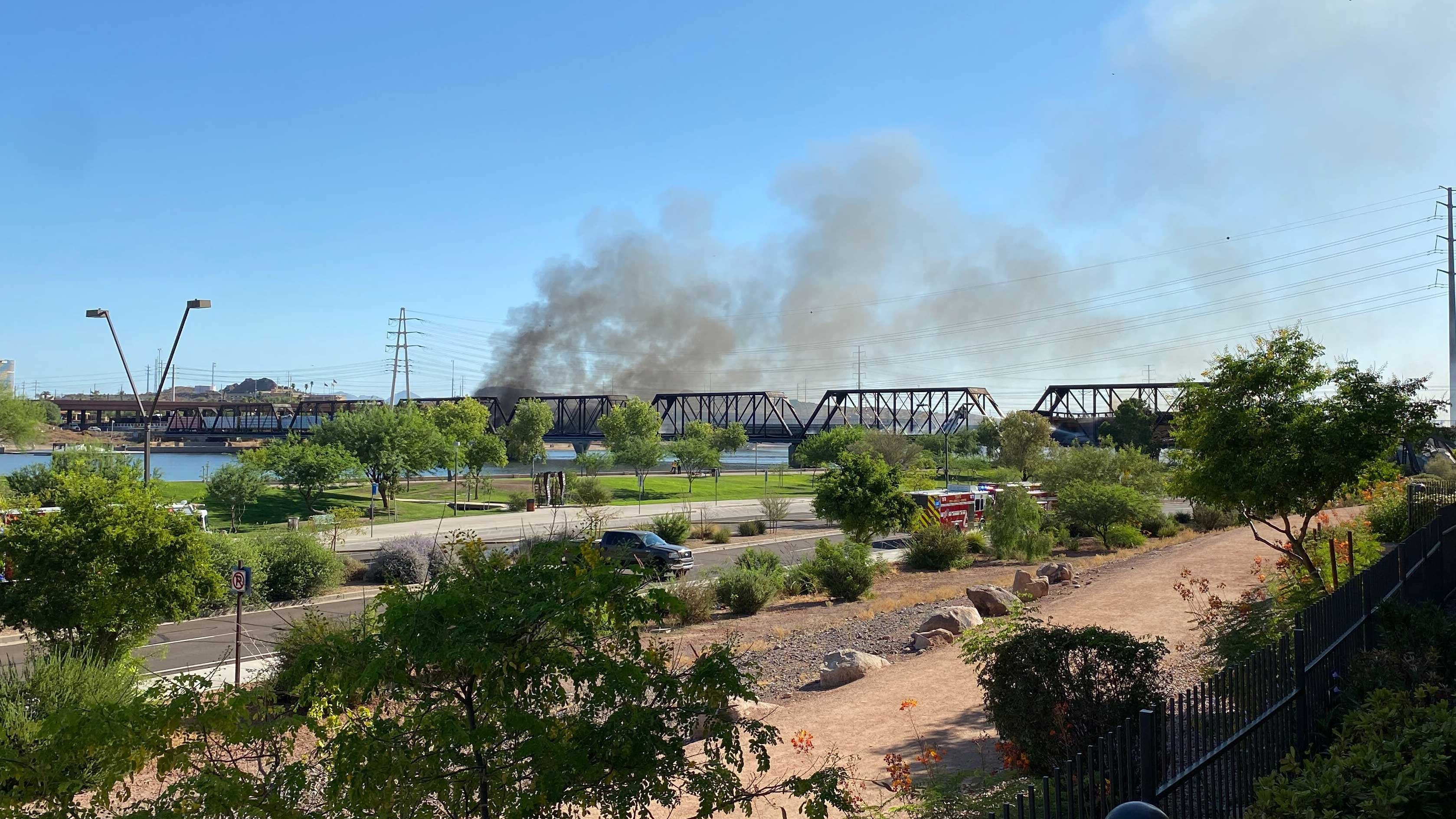 A train derailed on a bridge across Tempe Town Lake