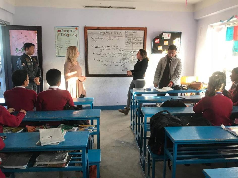 McDermott gives a presentation in a Nepalese classroom