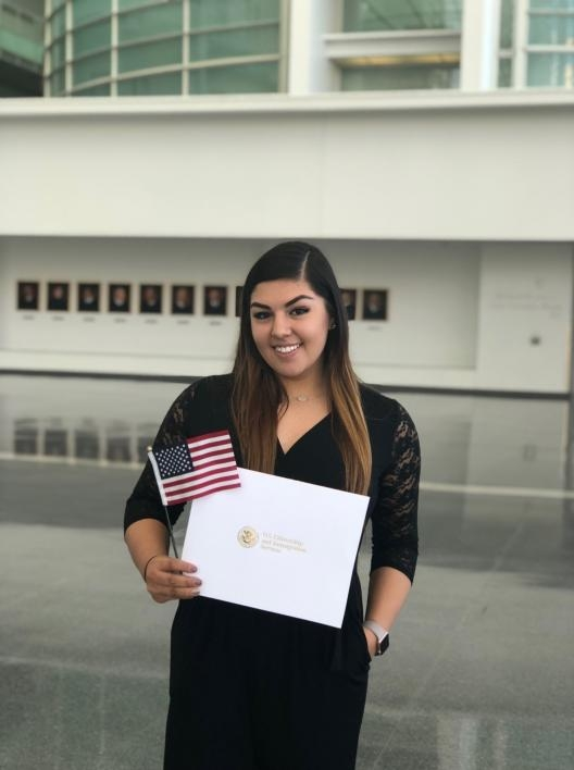 Hernandez holds her citizenship certificate and American flag