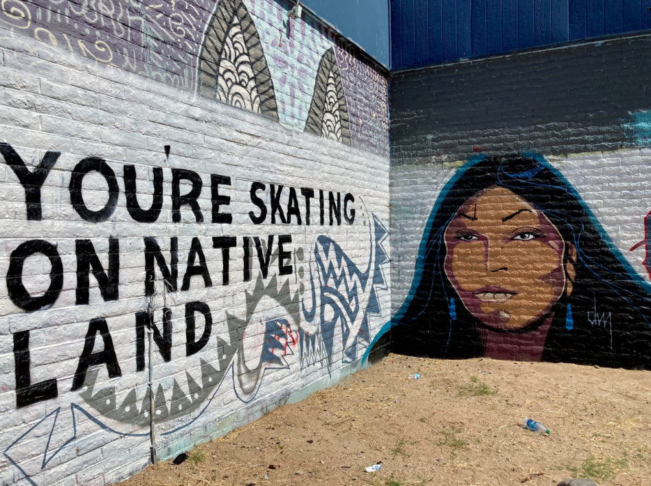 """Douglas Miles' mural of an Apache woman with the words """"You're Skating on Native Land"""" written across the wall"""