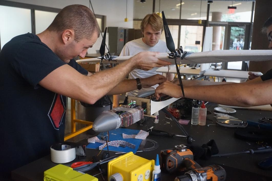 Luke Burgett (left) and Max Stauffer work on the aircraft at the Air Devils student organization workspace at Arizona State University