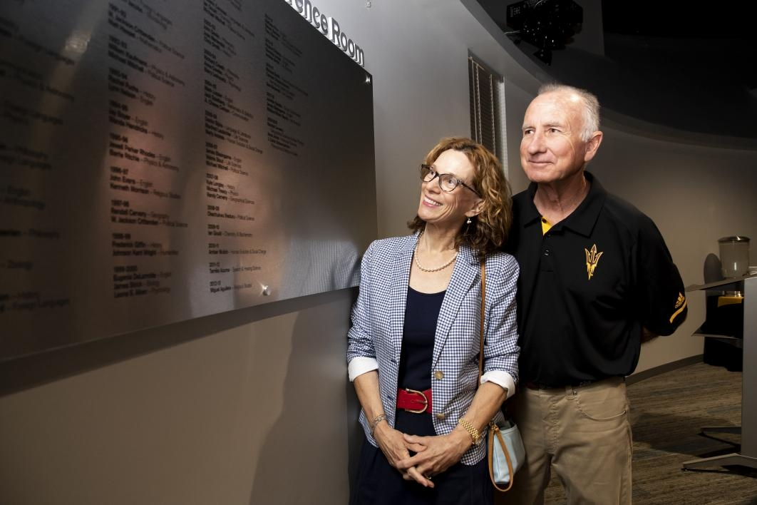 Pearce and his partner Donna Lenherr-Kinney look at the names of professors and instructors who have received The College's Zebulon Pearce Distinguished Teaching Awards since the award series' inception in 1973.