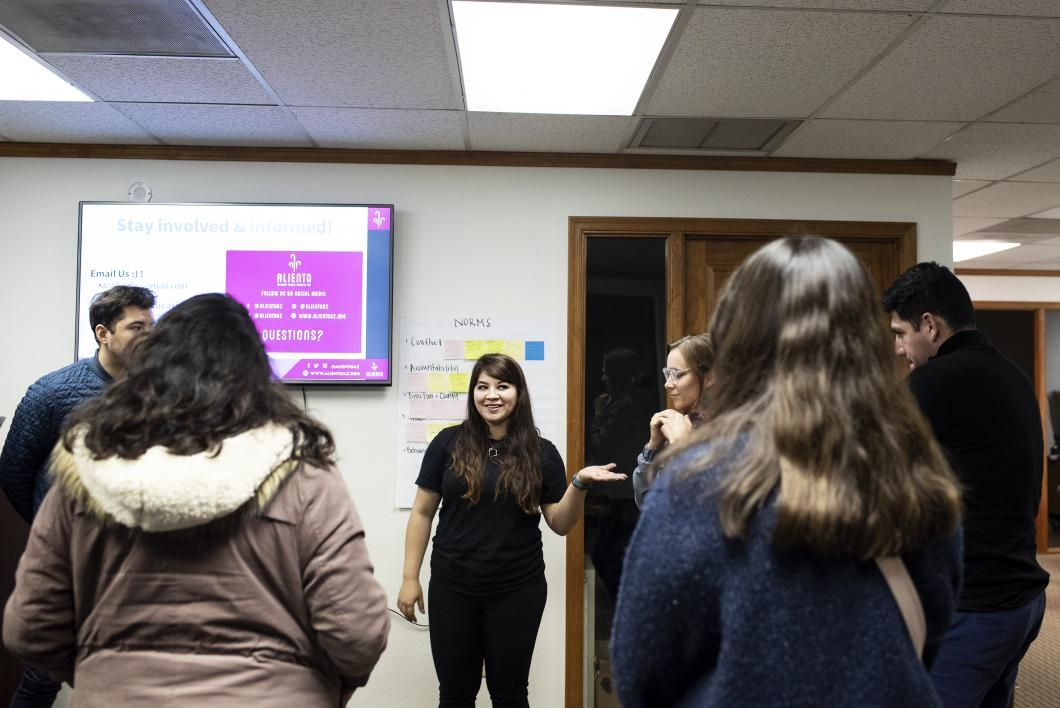 Aliento founder Reyna Montoya leads an informational meeting at the group's office in Mesa, Arizona.