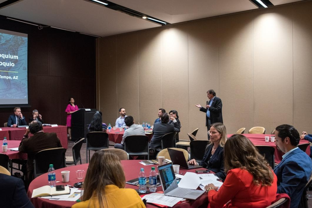 Audience members engage with colloquium panelists about barriers facing cross-border research, and possible pathways to overcome them.