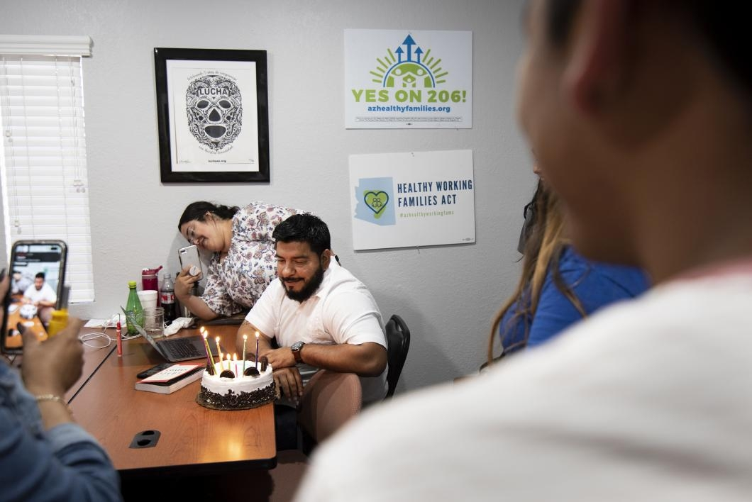 Tomas Robles, co-executive director of LUCHA AZ, celebrates his birthday with fellow volunteers and student activists at the advocacy network's Phoenix headquarters.