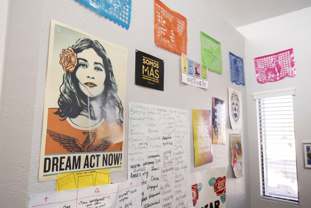 A collection of posters and signs used for demonstrations hang inside the Phoenix headquarters of LUCHA AZ.