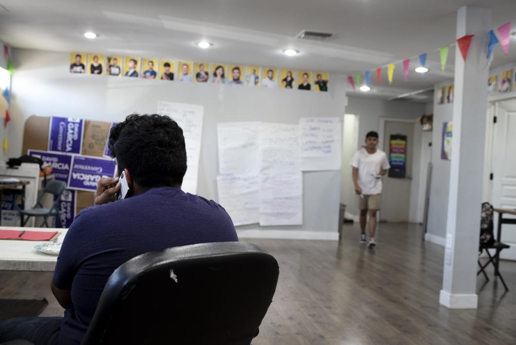 A high school volunteer organizes details of an upcoming youth leadership conference at the Phoenix headquarters of LUCHA AZ.