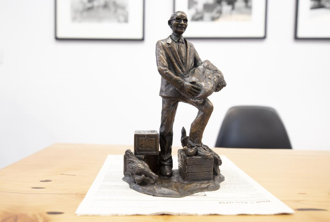 A miniature statue of Zebulon Pearce commissioned by Arthur Pearce II shows him surrounding by the goods that build his early businesses in Mesa—apples, feed, potatoes and Coors.