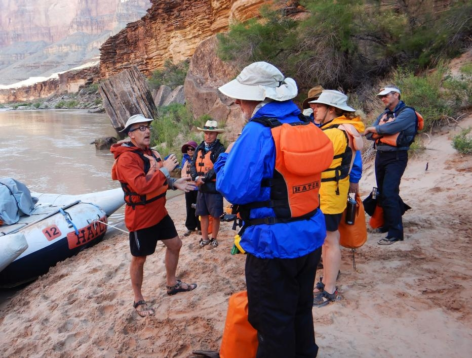 School of Earth and Space Exploration professor Ramon Arrowsmith describes the geological sites ahead to a group of passengers taking part in the Institute of Human Origins' Colorado River trip last May.