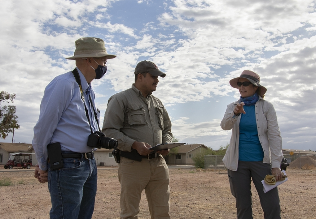 CISA's dean and faculty members discuss the project at the vacant lot where owl habitats are being constructed