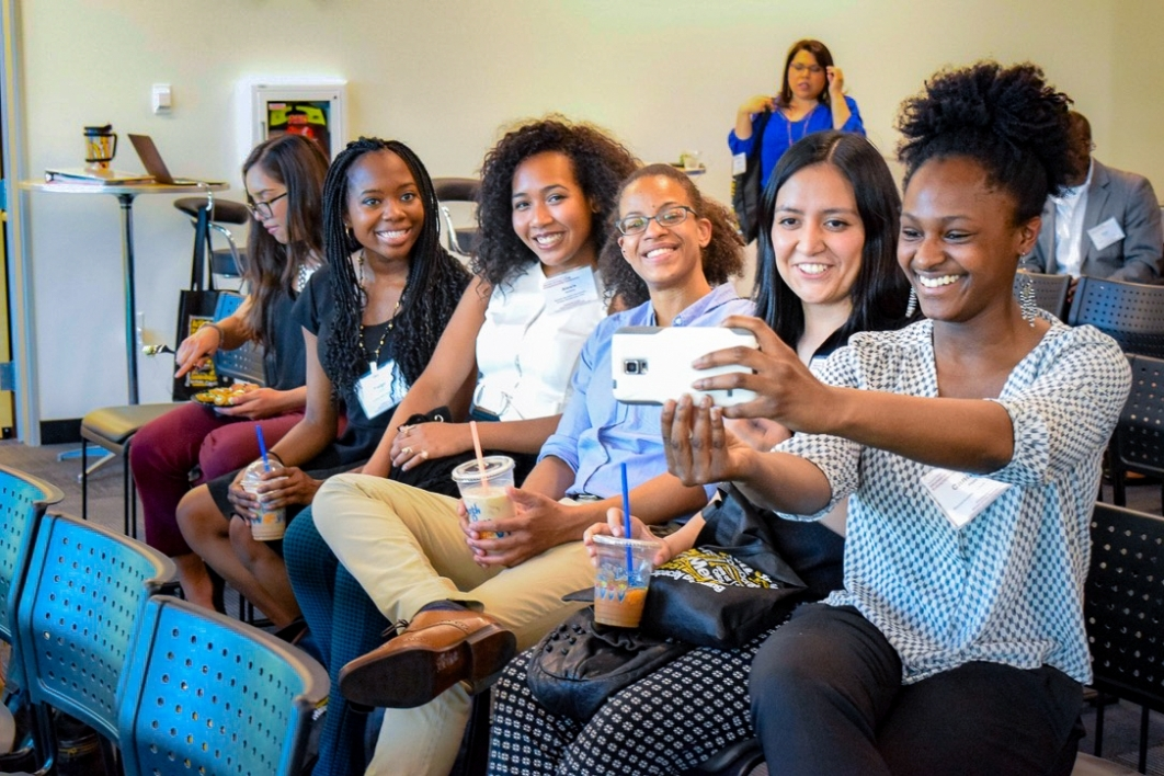 Women gather for a group photo during Women of Color STEM Entrepreneurship conference