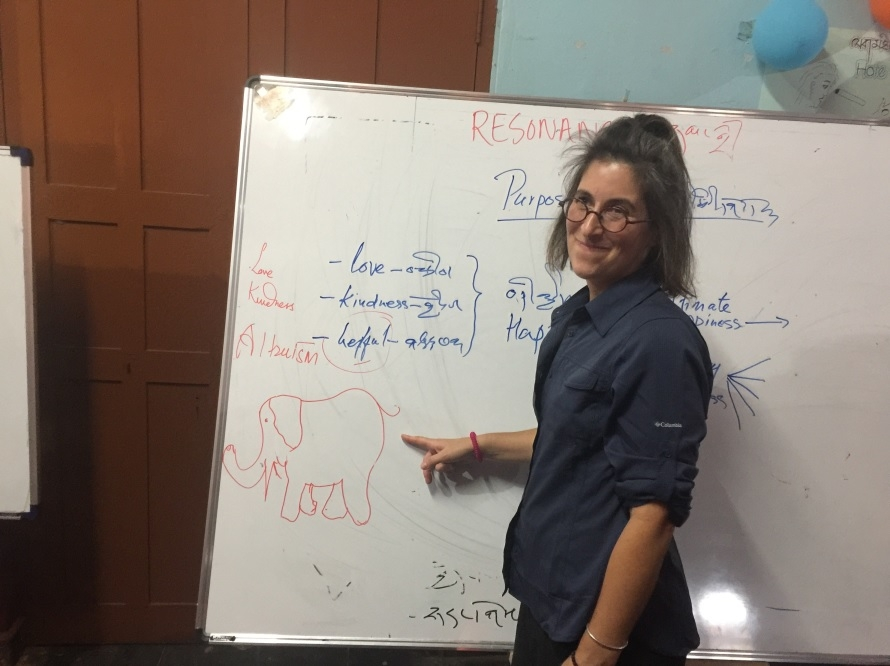 Jessica Early pointing to a white board