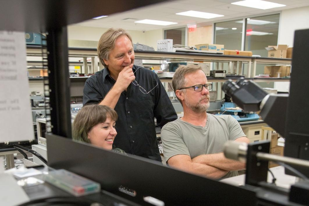 Associate Professor Hugh Barnaby (right) and Professor Michael Kozicki (center) apply their expertise in radiation effects and memory to test next-generation neuromorphic computing architectures for use in critical applications where radiation is a likely