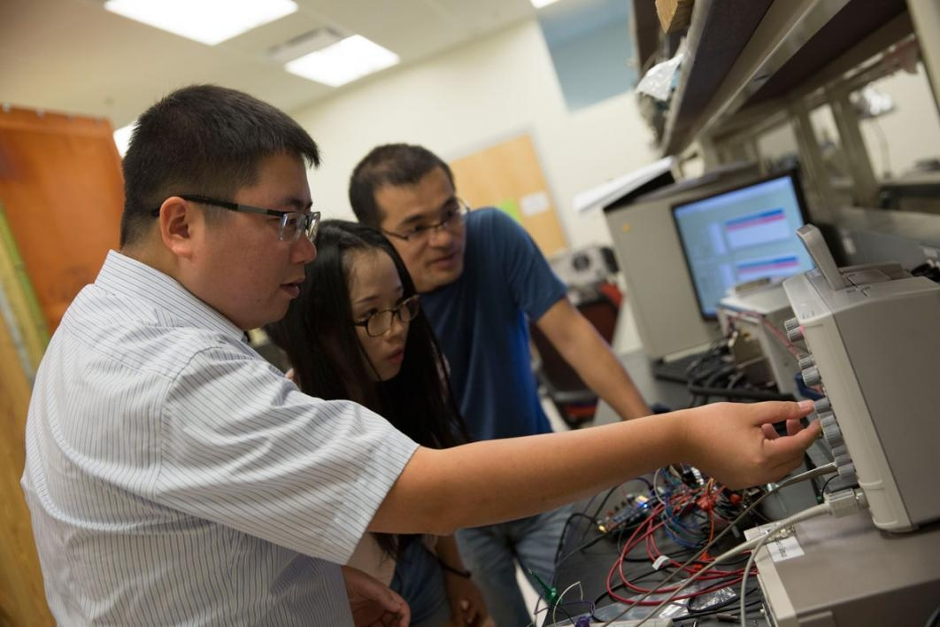 Assistant Professor Shimeng Yu (left) was recently awarded a National Science Foundation CAREER Award for his work related to neuro-inspired computing. He brings his expertise in higher-level computing architectures to help the team design neuromorphic ar