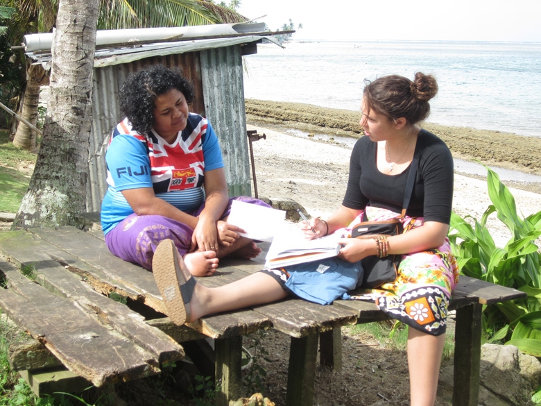 An ASU student interviews a woman in Fiji as part of a research project.