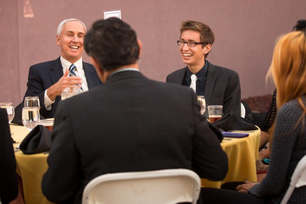 People laughing it up at a dinner event.