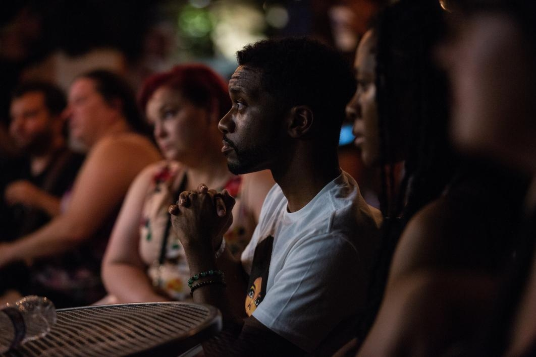 people in an audience listening intently