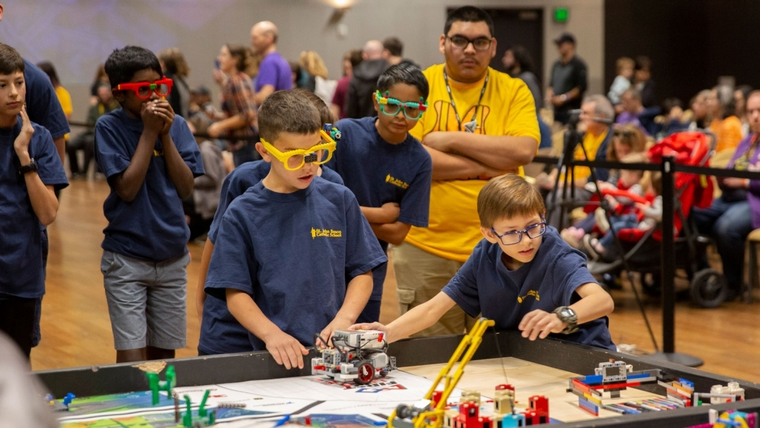 Students participate in the FIRST LEGO League state championship tournament.