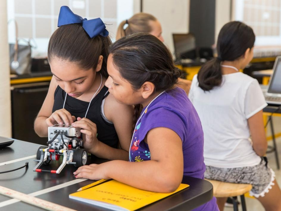Girls build robots at Lego camp