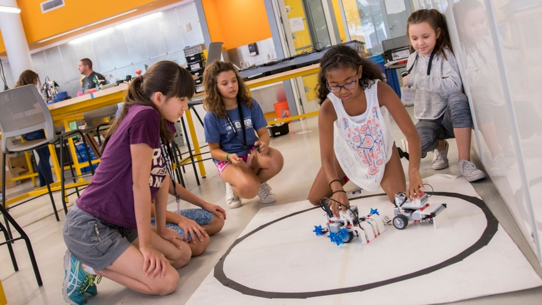 Girls participate in a FIRST LEGO League summer camp.