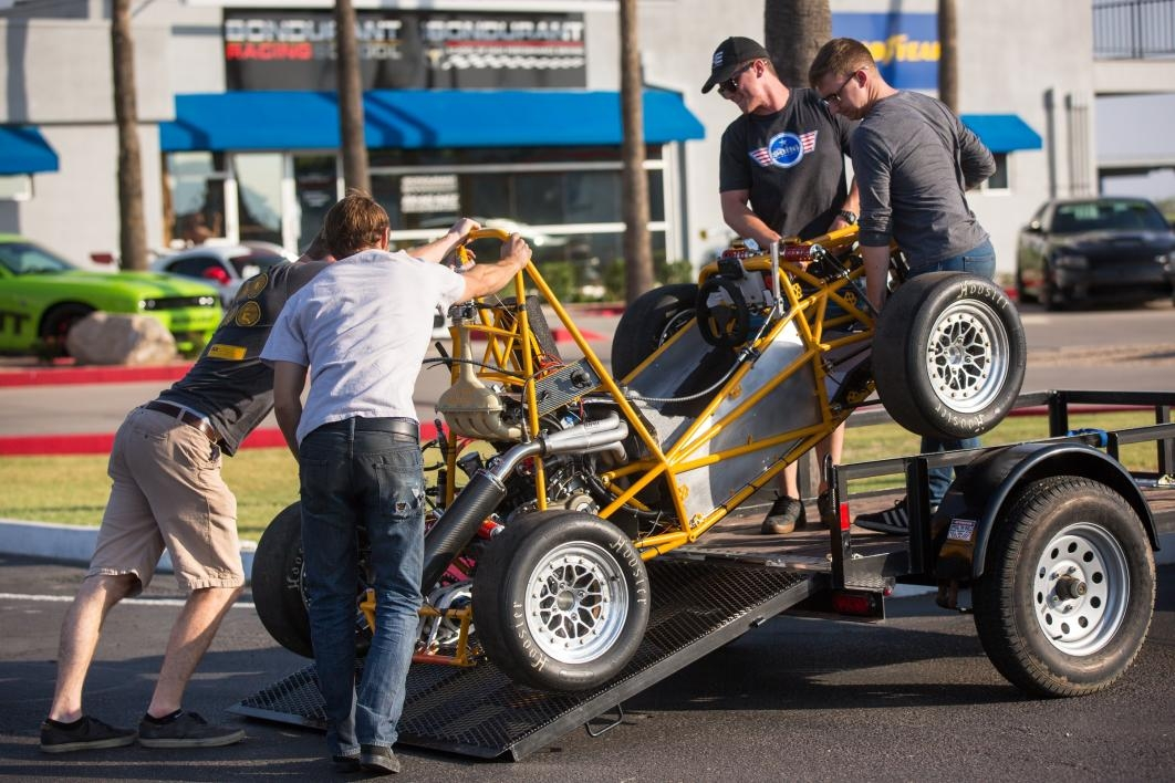 Students unload their race car at the test track.