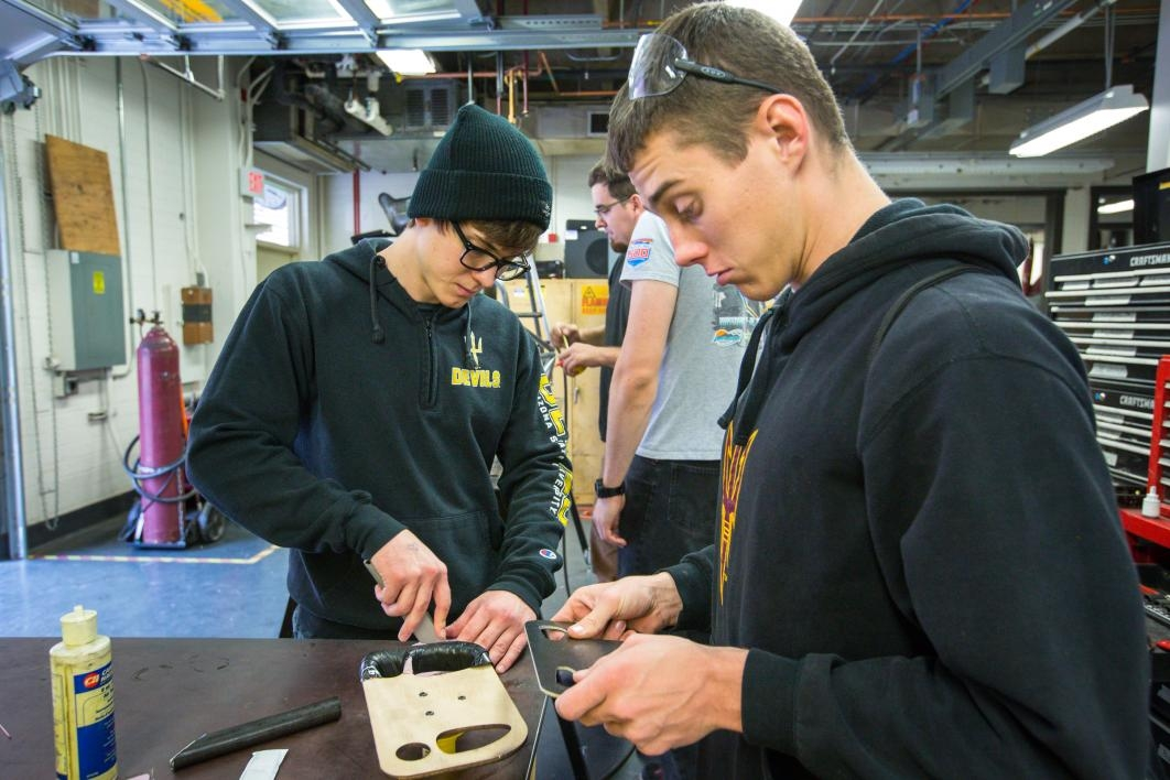 Students work on a steering wheel.
