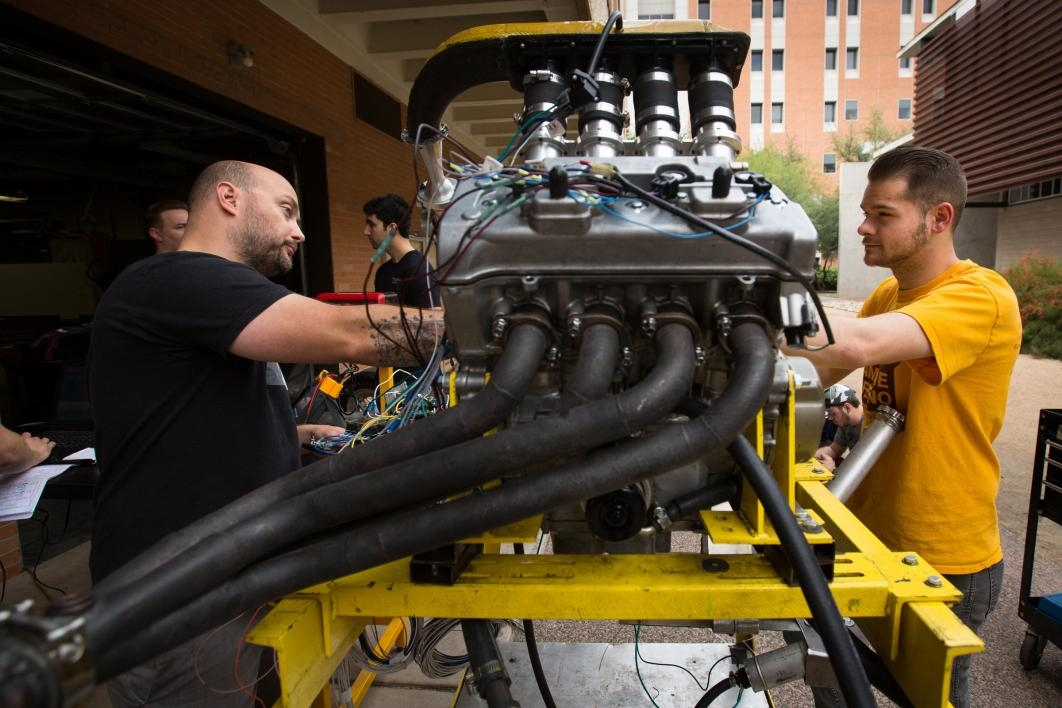 Formula SAE students work on the engine.