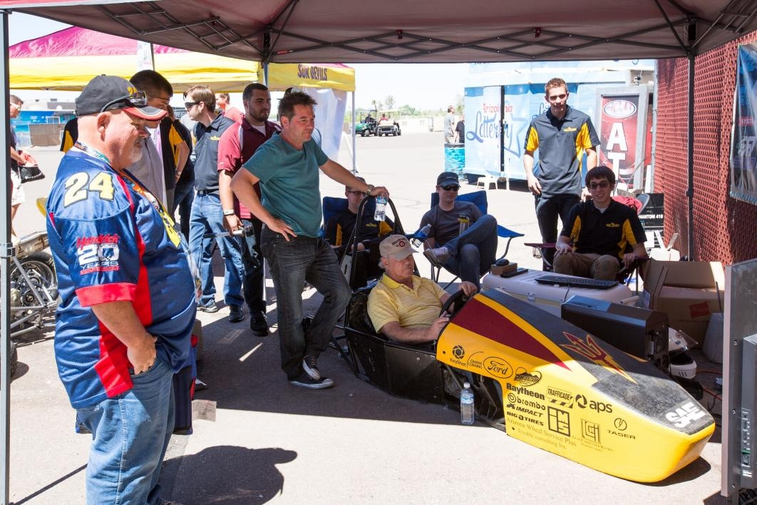 Race fans play with a car simulator at PIR.