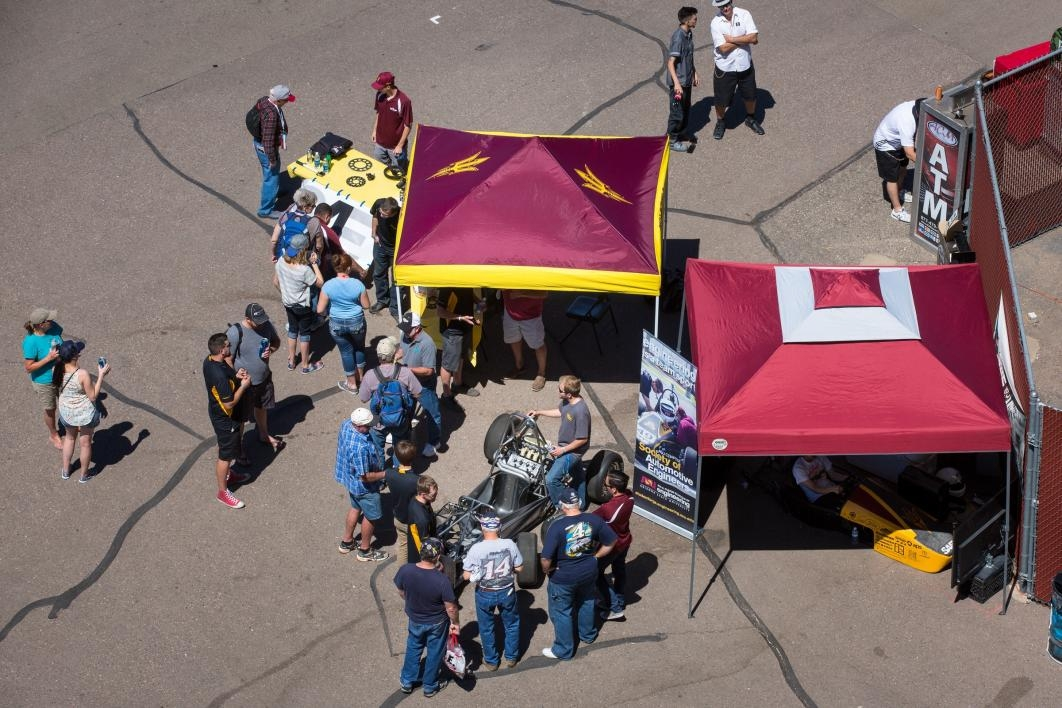 An aerial shot of the two tents of the motorsports team at PIR.