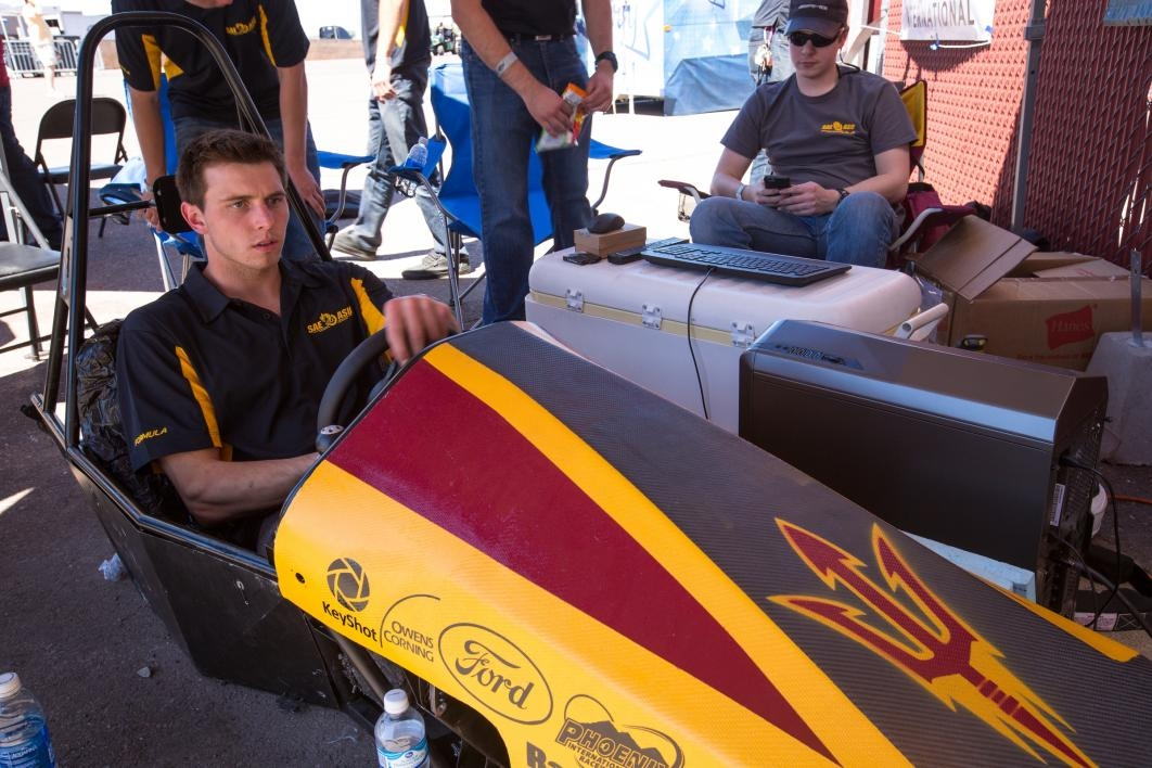 A student plays in the race-car simulator.