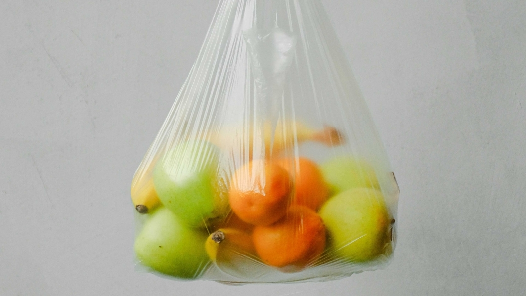 A variety of fruit in a plastic bag