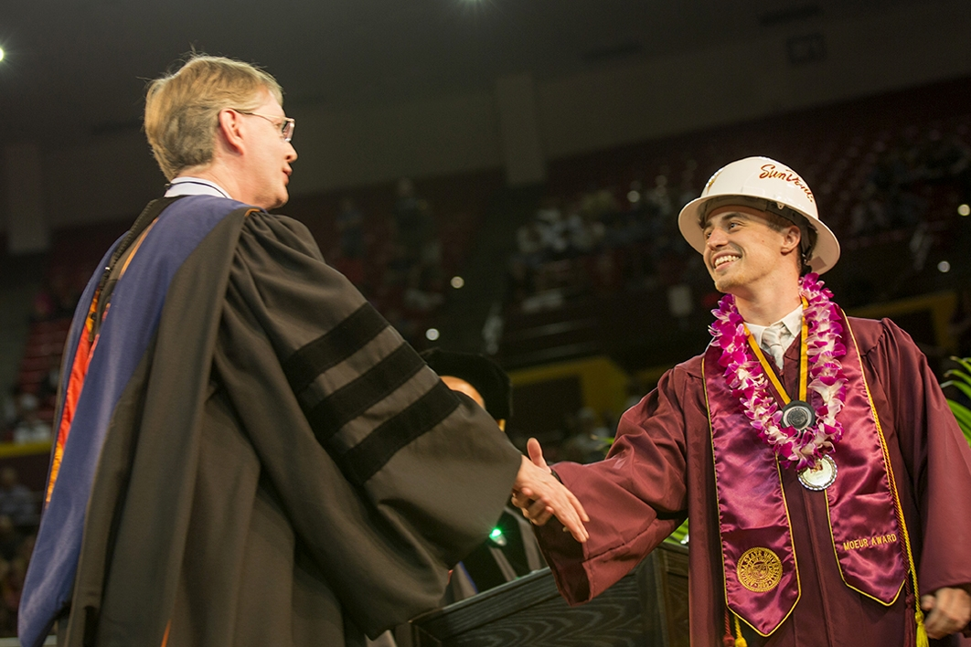 graduate shaking hands with dean