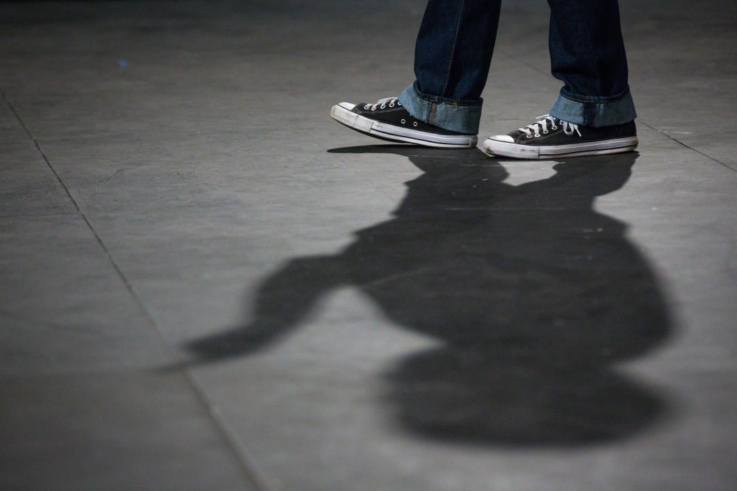 A student's feet and shadow.